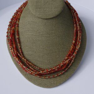 Women`s gold tone fall colors beaded necklace.